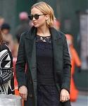November_15_-_Leaving_her_hotel_in_New_York_City_before_she_heads_to_Mockingjay_Fan_Press_Event_282029.jpg